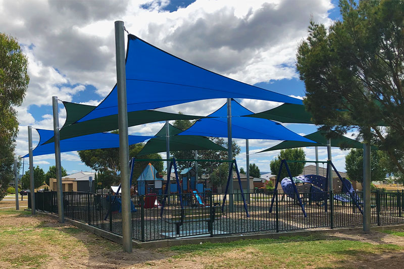 Blue shade sails, large shade structure, playground shade, latrobe city council, hammersmith circuit, traralgon, wind corridor, bigger footings, triangle, twist, posts, activity playgrounds