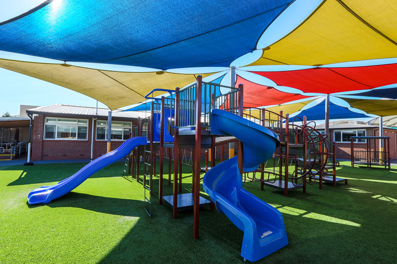 sirius college, activity playgrounds, school, kids, playground, older kids, large, big, double blue plastic slide, spiral slide, melbourne, victoria, australia