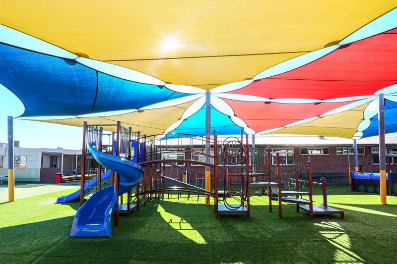 sirius college, activity playgrounds, school, kids, playground, older kids, large, big, double blue plastic slide, spiral slide, bridge, melbourne, victoria, australia