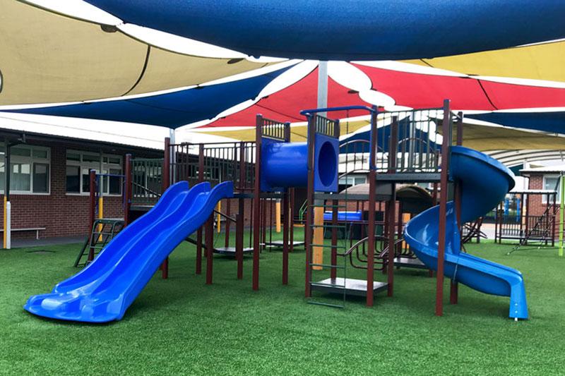 sirius college, activity playgrounds, school, kids, playground, older kids, large, big, double blue slide, spiral slide, crawl tunnel, melbourne, victoria