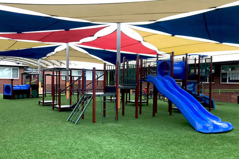 sirius college, activity playgrounds, school, kids, playground, older kids, large, big, double blue plastic slide, pommel walk, melbourne, victoria