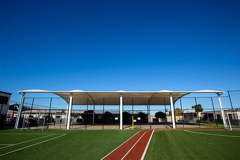 Barrel Shade, Sirius College, Under cover, basketball area, shade, sail, steel posts, giant, huge, large, basketball, court, assembly, area
